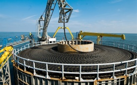 A three phase AC wire of 60 km length and 3.500t of weight connects the first german offshore windpark to the german energy grid.